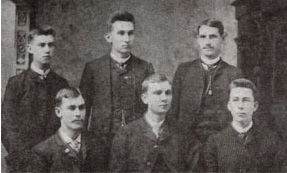 Seated: George R. McVey, Epsilon, Founder; Charter members: Robert E. Downing, P4; William D. Magruder, P5. Standing: Julian H. Pearson, P2; George L. Belcher, P3; John M. Evans, P1.